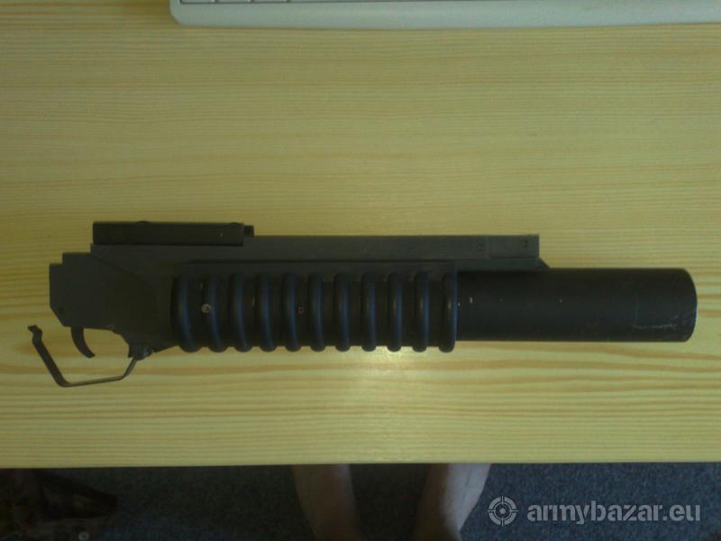 M203 viměním za batoh nebo tak tickou vestu
