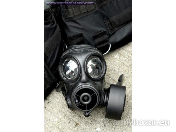Military gas mask in camoflage rucksack